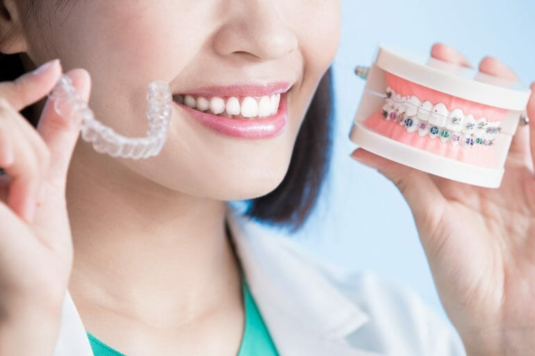 Woman Comparing Invisilign With Braces